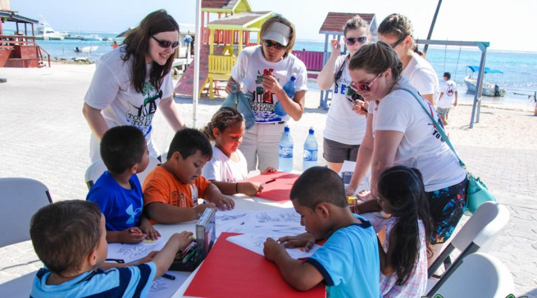 Projects Abroad volunteers managing kids at a Youth Development Project in Belize.